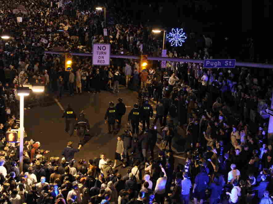 Police (center) had to move in to disperse the crowd in the streets of State College, Pa., Wednesday night after students and others gathered to protest the firing of football coach Joe Paterno.