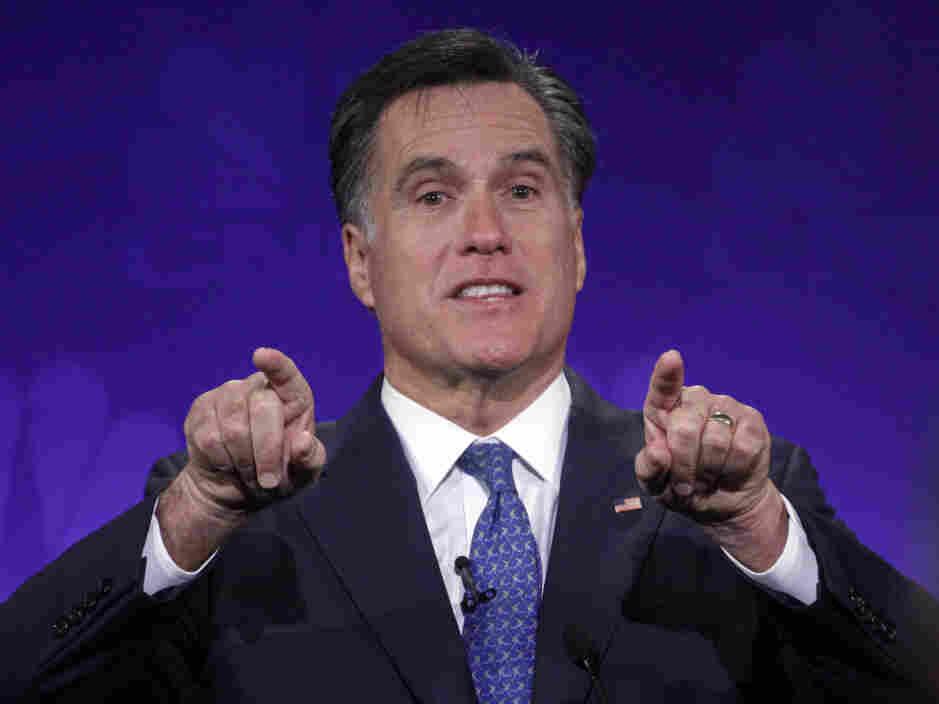 Mitt Romney gestures forcefully at the GOP presidential debate at Oakland University in Auburn Hills, Mich.,  Nov. 9, 2011.