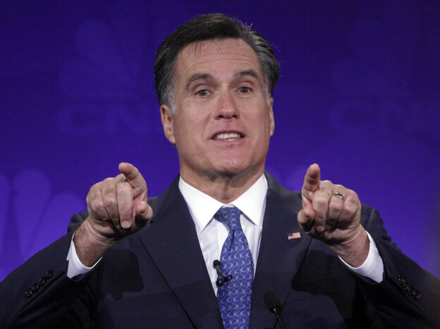 Mitt Romney gestures forcefully at the GOP presidential debate at Oakland University in Auburn Hills, Mich.,  Nov. 9, 2011.