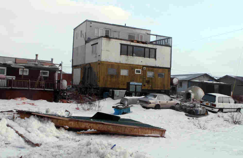 Part of a house roof lies on the ground in Nome, Alaska, after a storm with hurricane force winds and heavy snow struck the state Wednesday.