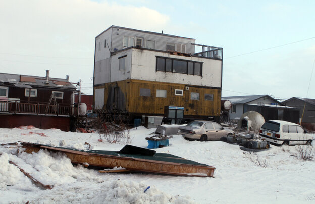 Part of a house roof lies on the ground in Nome, Alaska, after a storm with hurricane force winds and h