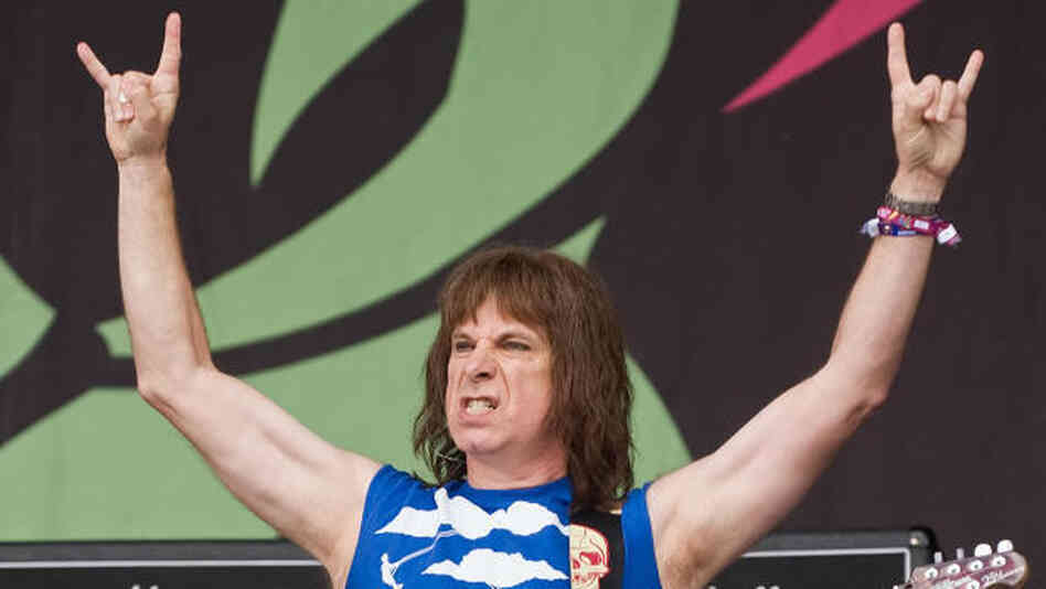 The Devil's 11's: Spinal Tap's Nigel Tufnel (a.k.a. Christopher Guest) in concert in 2009. If only he had three arms.