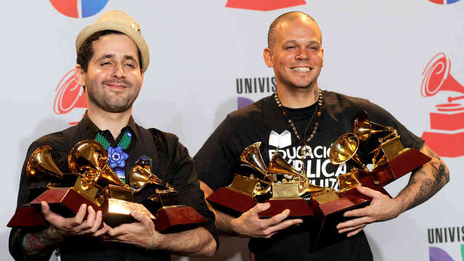 Calle 13, who are Eduardo Cabra Martinez a.k.a. Visitante (on the left) and Rene Perez Joglar a.k.a. Residente, pose with their Grammy Awards in Las Vegas Thursday night.