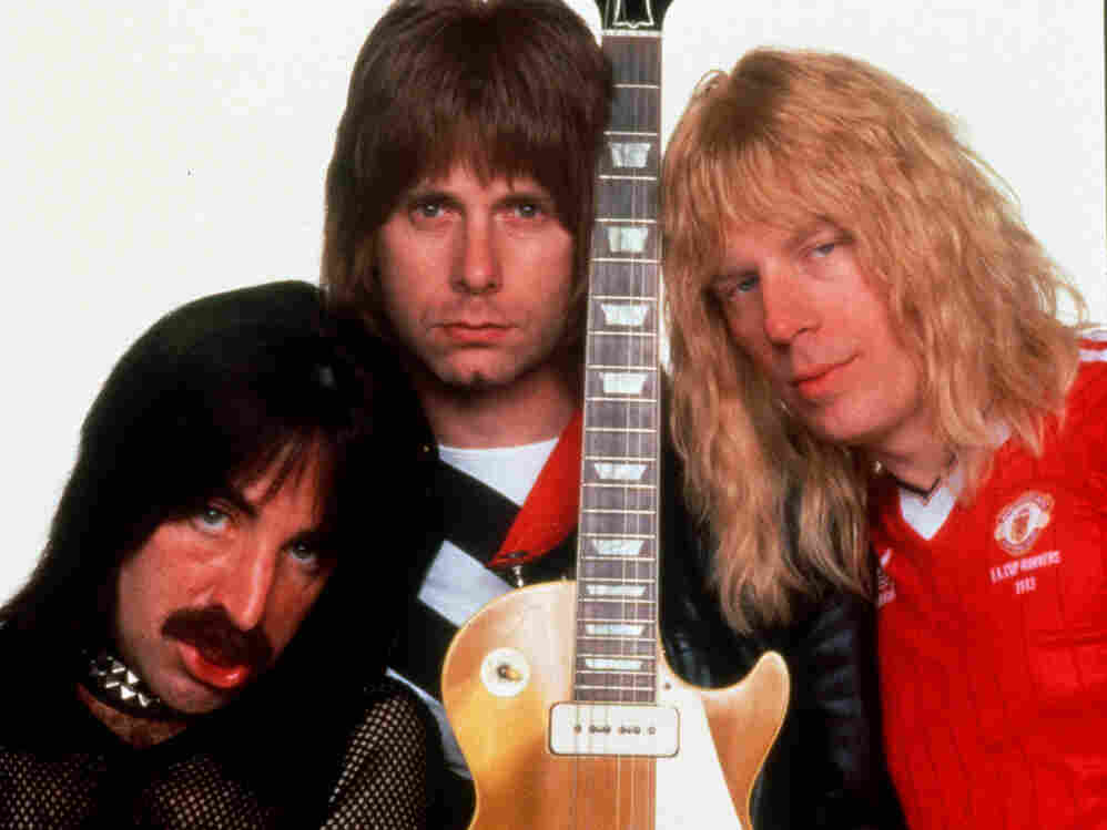 This file photo originally supplied by MGM Home Entertainment shows Harry Shearer, left, Christopher Guest, center, and Michael McKean playing the British band Spinal Tap, created for Rob Reiner's 1984 mock rockumentary This Is Spinal Tap.