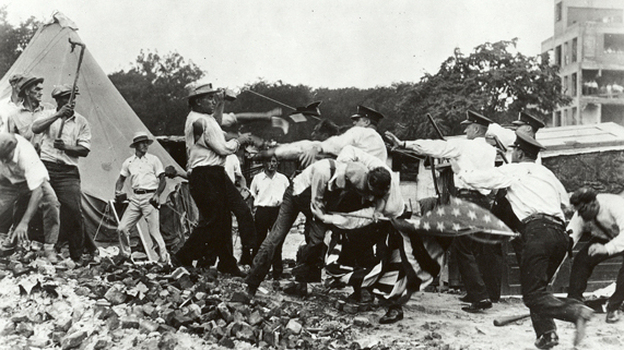 On July 28, officials sent in the Washington police to evict the marchers. The action was peaceful until someone threw a brick, the police reacted with force, and two bonus marchers were shot. The situation quickly spiraled out of control.   (The National Archives)