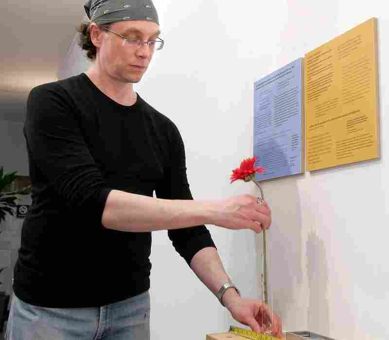 Perfumer Christopher Brosius adds a scented flower to his first solo exhibition at the Klein Art Gallery in Philadelphia in 2006. Brosius first started experimenting with scents when he worked at the cosmetic company Kiehl's in the late '80s.
