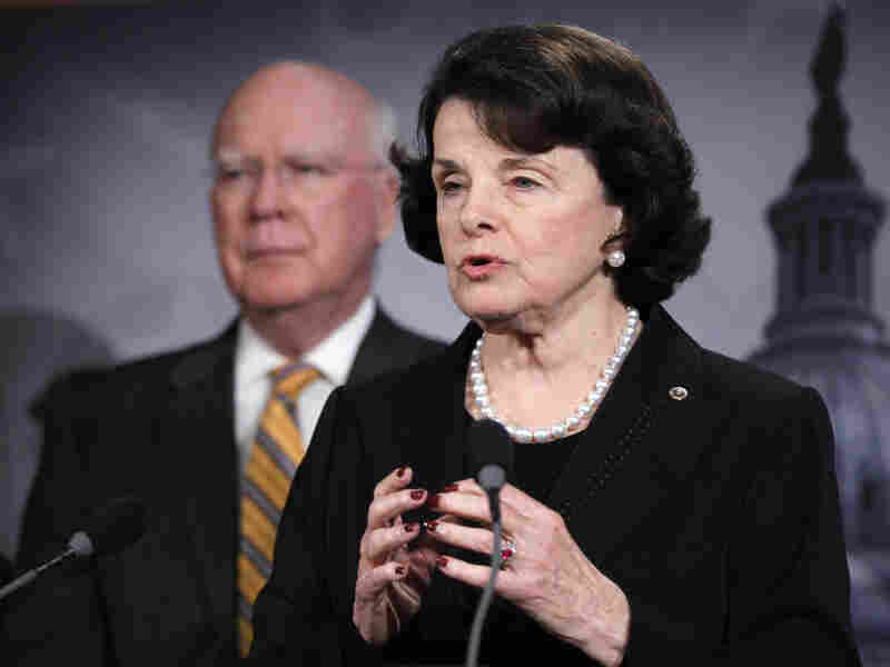 Sen. Dianne Feinstein, D-Calif., accompanied by Senate Judiciary Committee Chairman Patrick Leahy, D-Vt., gestures during a news conference on Capitol Hill on Thursday to discuss committee action on legislation to repeal the Defense of Marriage Act.