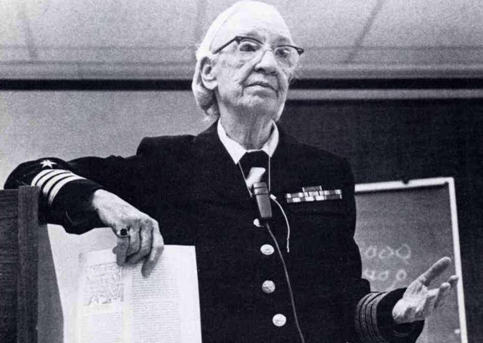 Grace Murray Hopper was a Navy rear admiral who in 1946 compiled a 500-page manual for the Harvard Mark I, one of the earliest programmable computers.  She developed the first compiler, which allowed programmers to code in their own language instead of rows of 1s and 0s, and later worked on computer languages.
