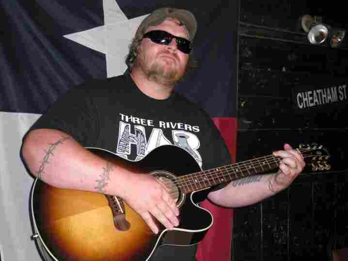 In front of the Texas flag: Iraq vet and aspiring songwriter Buddy Lee Dobberteen.