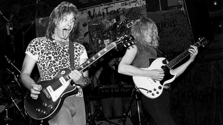 The fictitious band from This Is Spinal Tap performs live at CBGB's in New York in 1984. Nigel Tufnel, the guitarist played by Christopher Guest, favored amplifiers whose volume could be cranked up to 11.