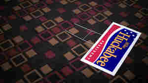 A sign for Republican presidential candidate and former Arkansas Gov. Mike Huckabee lies on the ground at a campaign event at the Best Western Fun City in Burlington, Iowa, on Jan. 3 2008.