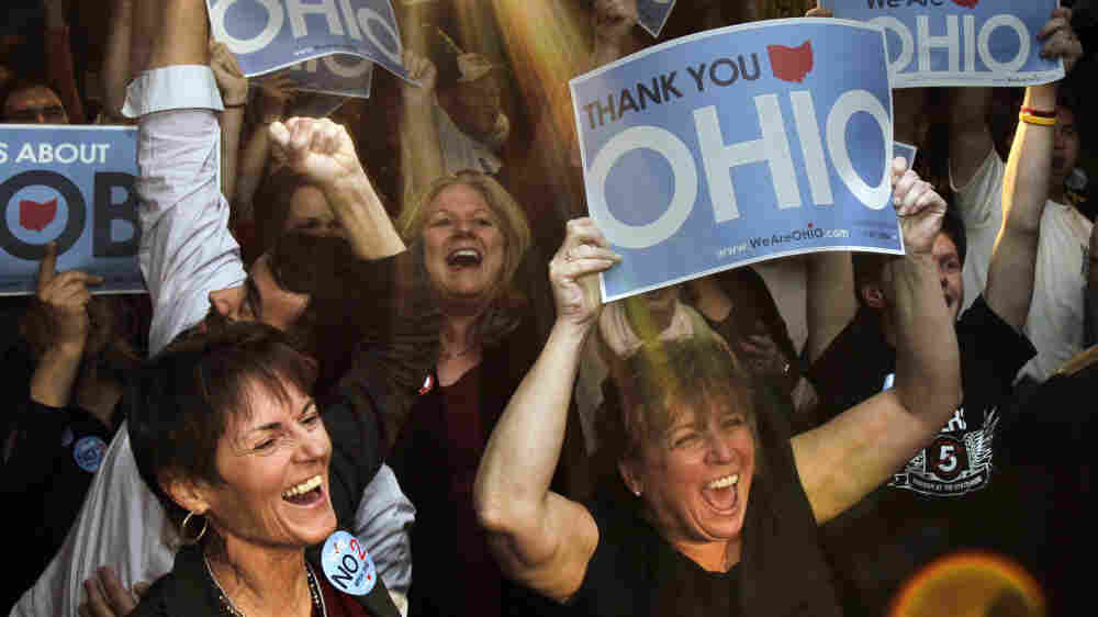 Supporters of teachers unions cheer at a rally in Cleveland after the defeat of Issue 2 on Tuesday.