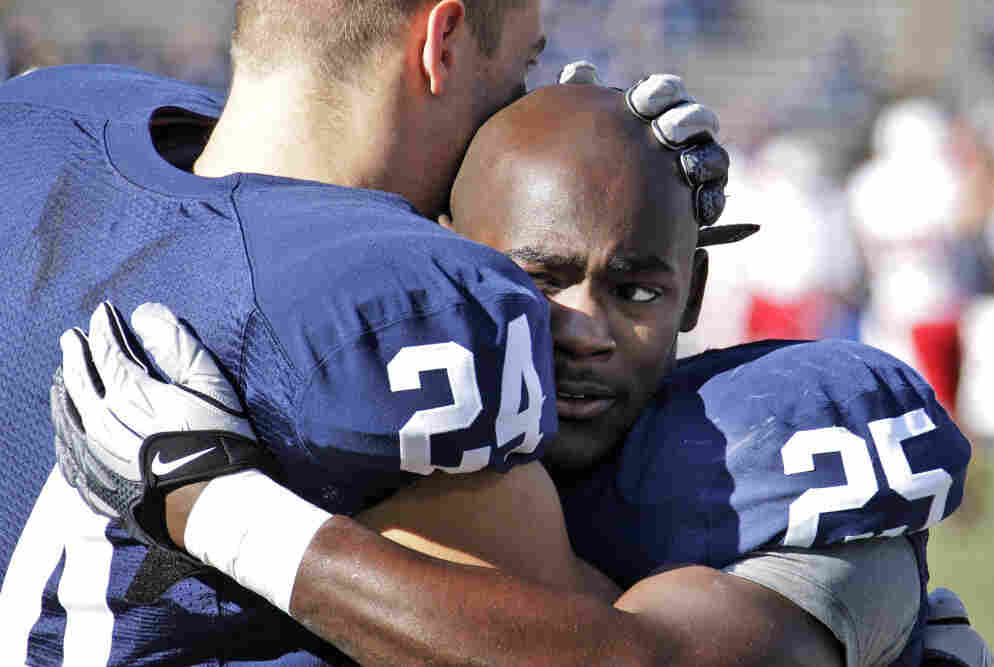 Penn State running backs Derek Day (24) and Silas Redd (25) hug during warm ups before the game.