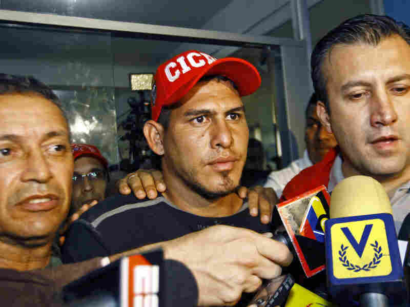 Washington Nationals' catcher Wilson Ramos, center, talks to journalists at the Criminal Police headquarters in Valencia, Venezuela, Saturday. Venezuelan police commandos rescued Ramos Friday, two days after he was kidnapped.