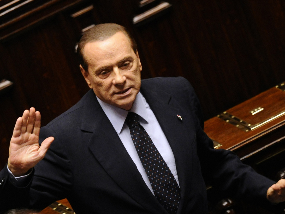 Italian Prime Minister Silvio Berlusconi acknowledges applause before leaving parliament's lower chamber in Rome on Saturday. Berlusconi resigned after the lower chamber passed an austerity package.
