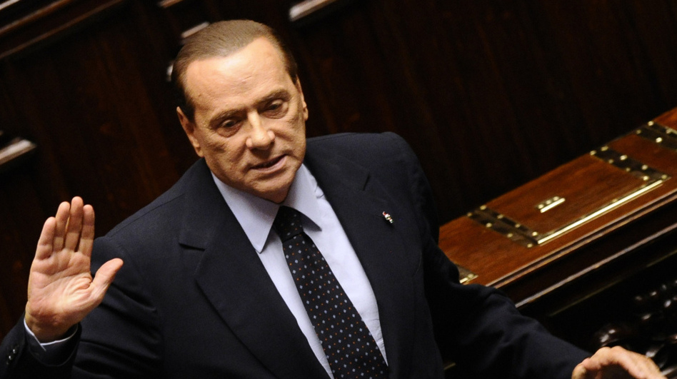 Italian Prime Minister Silvio Berlusconi acknowledges applause before leaving parliament's lower chamber in Rome on Saturday. Berlusconi resigned after the lower chamber passed an austerity package.  (AFP/Getty Images)