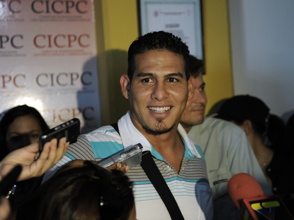 Washington Nationals catcher Wilson Ramos, seen here at a news conference on Saturday, has much to smile about: He was rescued just two days after he was kidnapped. Not all Venezuelans are that lucky. The government's own statistics show that 895 kidnappings were reported last year.