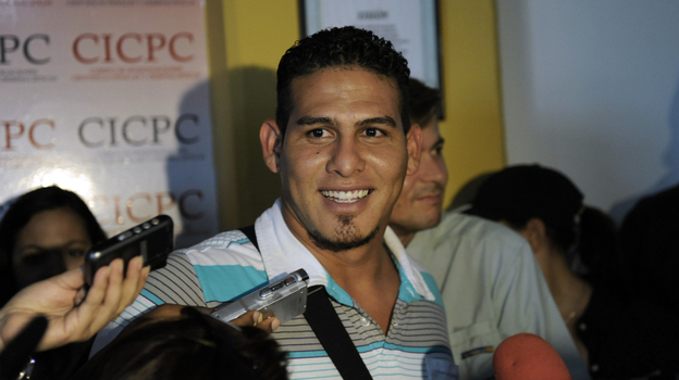 Washington Nationals catcher Wilson Ramos, seen here at a news conference on Saturday, has much to smile about: He was rescued just two days after he was kidnapped. Not all Venezuelans are that lucky. The government's own statistics show that 895 kidnappings were reported last year.  (AFP/Getty Images)