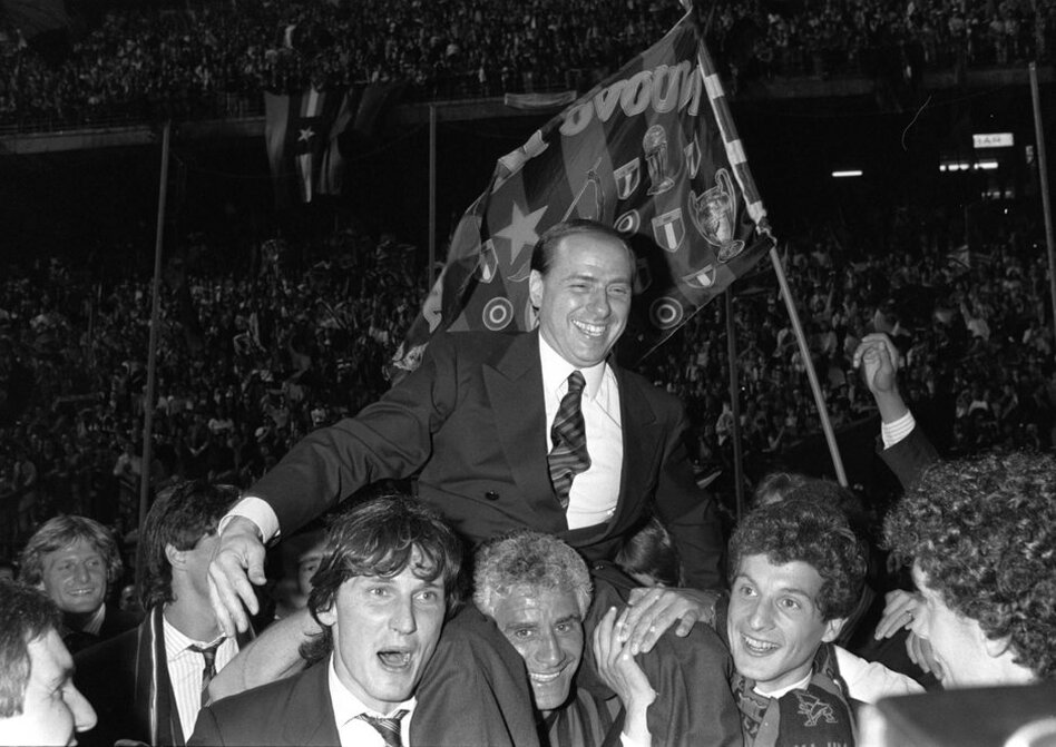 Berlusconi, then and still owner of football club AC Milan, is carried by Milan players after the team won the 1988 Italian soccer championship.  (AP)
