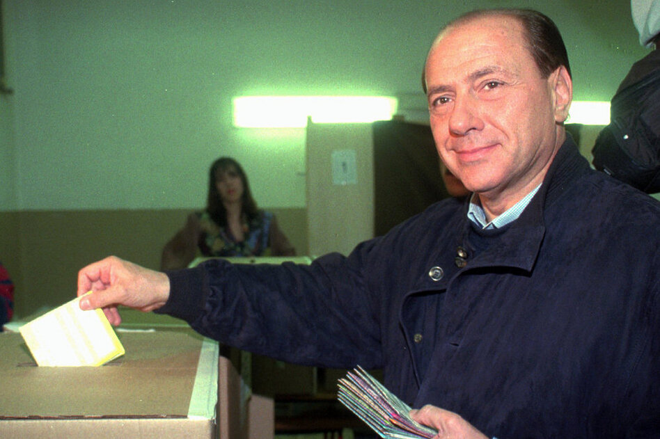 Silvio Berlusconi casts his ballots in the national referendum in Milan in 1995. The outcome of the referendum was decisive in determining the fate of Berlusconi's TV empire.  (AP)
