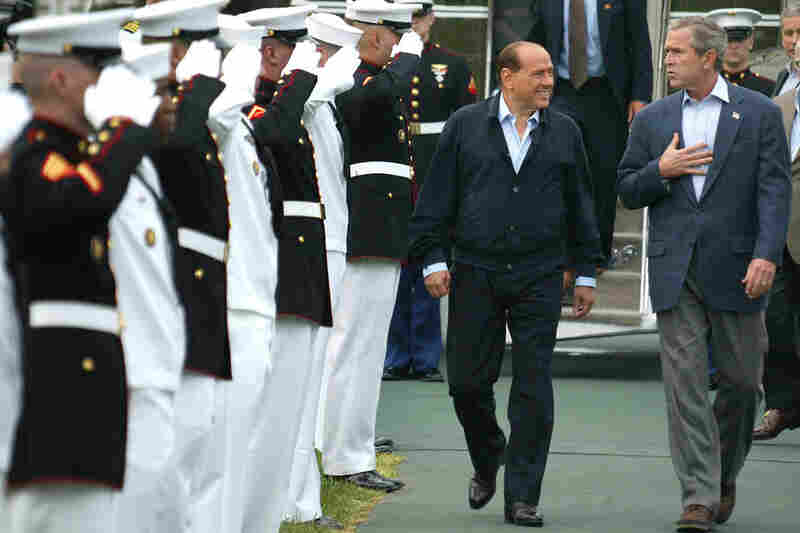 U.S. President George W. Bush (R) walks with former Italian Prime Minister Silvio Berlusconi after Berlusconi's arrival for a meeting at Camp David in 2002. The two leaders met to discuss the situation in Iraq.