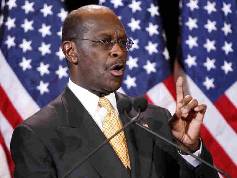 Republican presidential candidate Herman Cain addresses the media on Tuesday in Arizona. Cain said he would not drop his bid for the Republicans' presidential nomination in the face of decade-old allegations of inappropriate sexual behavior.