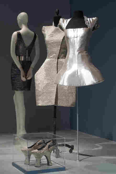 "Guinness' metallic couture dresses evoke armor and echo her trademark platinum-and-black hair. Guinness' style has inspired many couture designers, but, according to the Museum at FIT, she insists she is no muse — instead she describes herself as a ""bee"" flitting from one designer to the next."