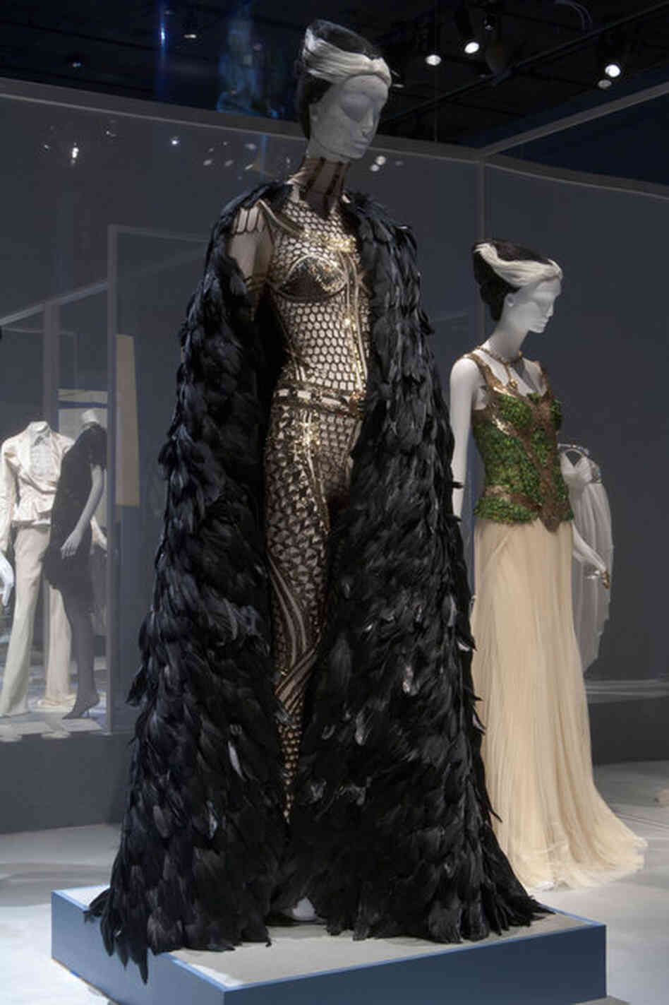 "Guinness' collection celebrates dramatic styles that often incorporate feathers and sparkle, both of which come together in this ensemble by the late Alexander McQueen. According to the Museum at FIT, designer Tom Ford describes Guinness as ""one of the — if not the — most stylish women living."""