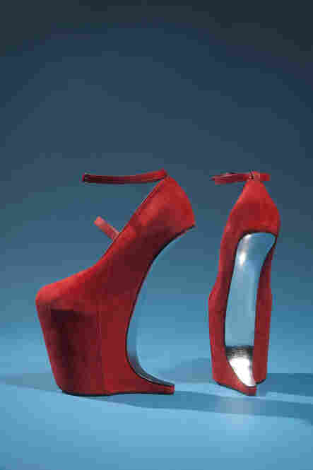 The Museum at FIT's exhibit includes a wide range of accessories, including red suede shoes by designer Nina Ricci. Guinness is so well-known for her towering platform heels that designers Christian Louboutin and Noritaka Tatehana have made shoes especially for her.