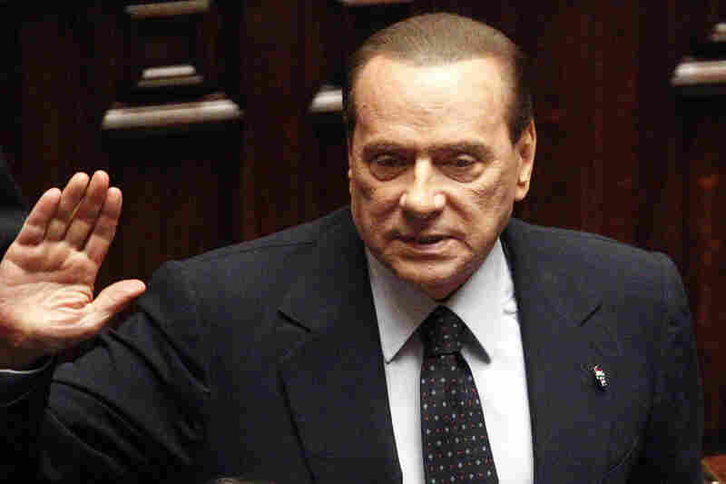 Italian Premier Silvio Berlusconi acknowledges applause before leaving parliament's lower chamber in Rome on Nov. 12. The lower chamber passed European-demanded reforms aimed at bringing Italy back from the brink of economic crisis. Berlusconi said he would resign once the reforms were passed.