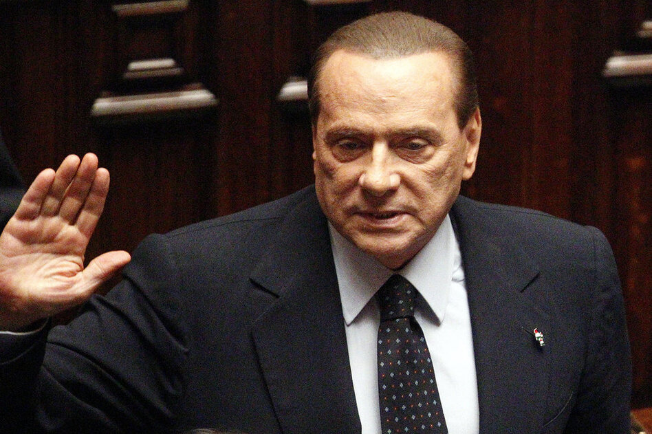 Italian Premier Silvio Berlusconi acknowledges applause before leaving parliament's lower chamber in Rome on Nov. 12. The lower chamber passed European-demanded reforms aimed at bringing Italy back from the brink of economic crisis. Berlusconi said he would resign once the reforms were passed.  (AP)