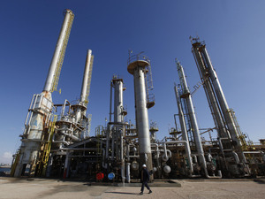 A worker walks in front of a refinery inside the Brega oil complex in Libya.