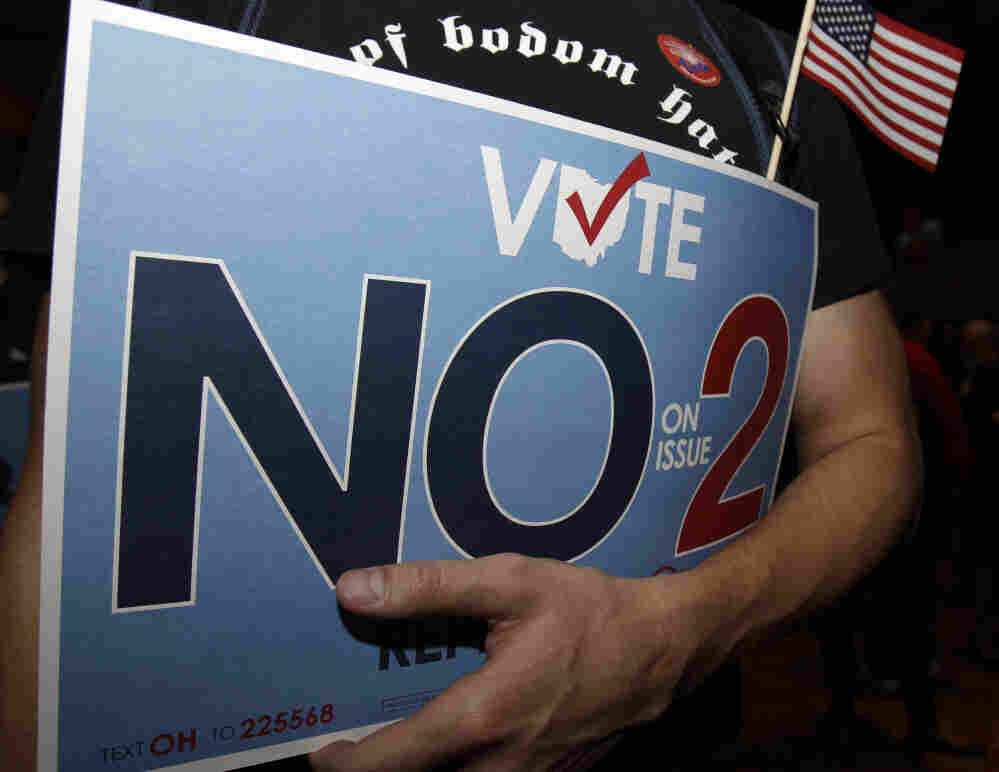 A supporter to repeal Senate Bill 5 holds onto his sign during a rally Tuesday in Columbus, Ohio. Ohio voters rejected a new law restricting the collective bargaining abilities of public employee unions in an unusually vigorous off-year election that drew attention across the nation.