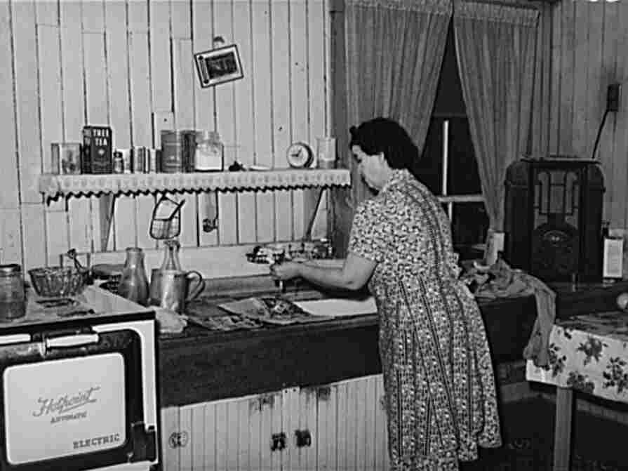 Woman washing dishes while listening to the radio.