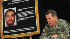 U.S. authorities must now decide the fate of Ali Mussa Daqduq — shown here on a poster at a 2007 U.S. military news conference in Baghdad — and other enemy combatants once troops withdraw from Iraq.