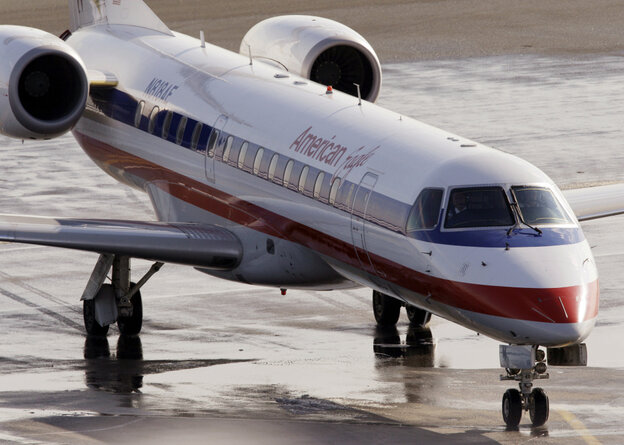 In this January 2011 file photo, an American Eagle jet taxis at Boston's Logan International Airport.
