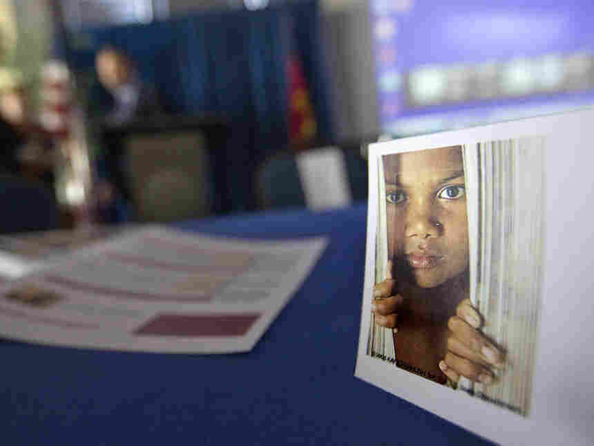 A placard featuring the photo of a child sits on a table during a conference on human sex trafficking last month in Atlanta. In Fairfax County, Va., gang members who have forced girls as young as 12 into prostitution are being sent to prison. Prosecutors there expect to bring more sex trafficking cases against gang members over the next several months.