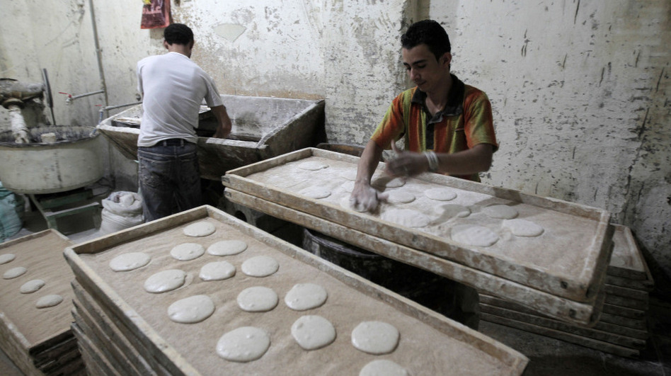 Egyptians are seen working in a bakery in Cairo. The U.S. has been working on ways to help revive the economies of nations in transition, like Egypt, Tunisia and Libya, while having limited resources available during tough economic times.