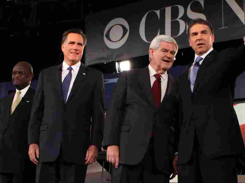 Republican presidential candidates businessman Herman Cain, former Massachusetts Governor Mitt Romney, former Speaker of the House Newt Gingrich (R-GA), and Texas Governor Rick Perry acknowledge audience prior to a presidential debate at Wofford College Nov. 12, 2011 in Spartanburg, South Carolina.
