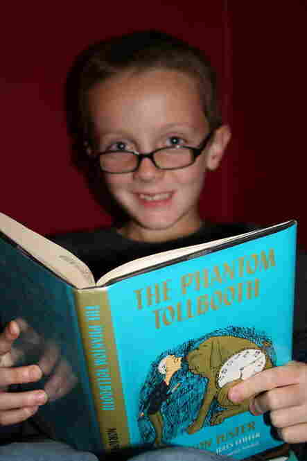 "Jack Stuart, 8, of Wauwatosa, Wis., is a second-generation Phantom Tollbooth reader. ""I loved it as a kid, and thought he would love it too,"" says his mother, Heather Stuart. Jack's favorite character is the Spelling Bee, and he says he likes the book because it's an adventure."