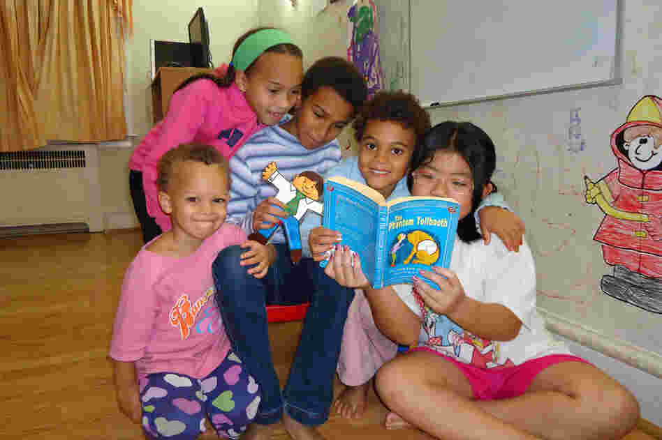 From left: Carina Jaffe, 3; Larissa Jaffe, 9; Denali Jaffe, 10; Zahra Jaffe, 6; and their friend Christina Tonnu, 8, read The Phantom Tollbooth together in Philadelphia.