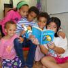 Carina Jaffe, 3; Larissa Jaffe, 9; Denali Jaffe, 10; Zahra Jaffe, 6; and their friend Christina Tonnu, 8, read The Phantom Tollbooth together in Philadelphia.
