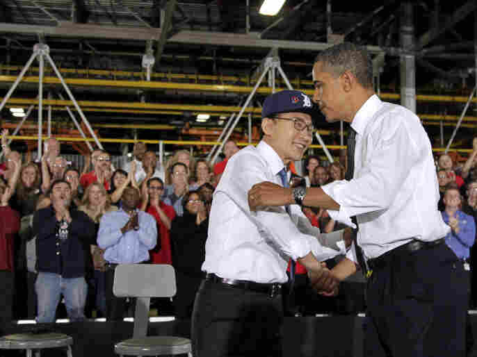 Presidents Obama and Lee embrace after touring and speaking at the General Motors Orion Assembly Plant in Orion Township, Mich., Oct. 14.