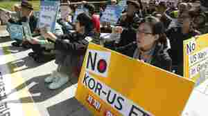 South Korean protesters shout slogans during a rally against a free trade agreement between South Korea and the United States near the U.S. Embassy in Seoul, South Korea, Oct. 11.