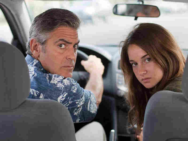 George Clooney plays an indifferent husband and father to two daughters, including Shailene Woodley, in The Descendants.