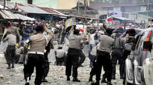 Police clash with workers of American mining company Freeport-McMoRan during a protest in Timika, Papua province, Indonesia, Oct. 10. Indonesian security forces fired on striking workers at Freeport-McMoRan's Grasberg gold and copper mine after a protest turned deadly.