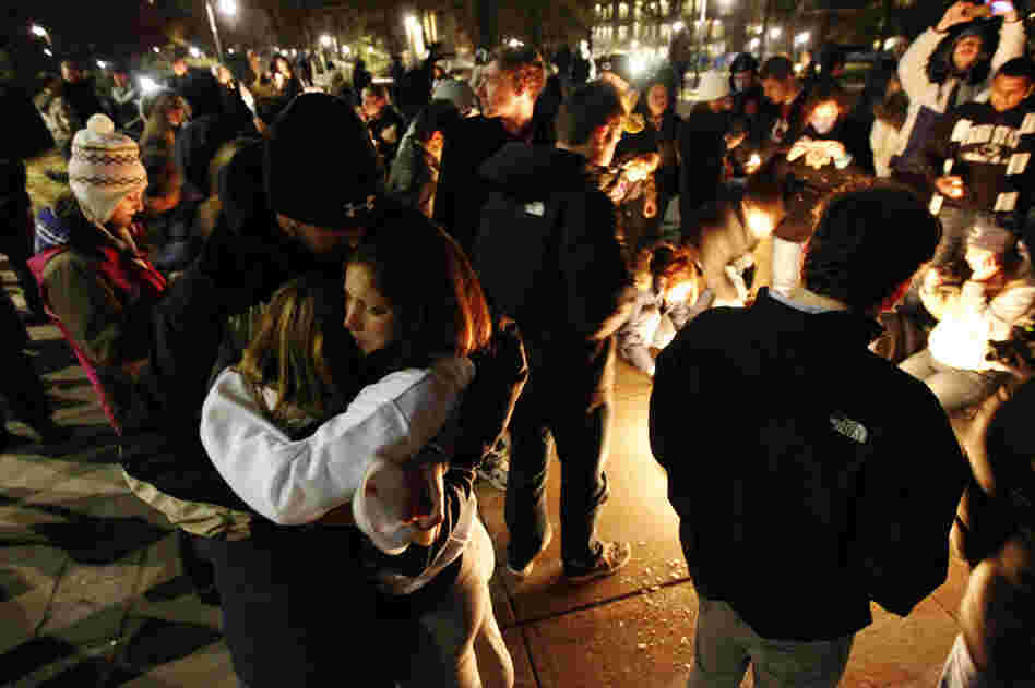 Students embrace after a candlelight vigil on the Penn State campus Friday, in State College, Pa. The vigil was held in support of victims of child sexual abuse amid a scandal involving former assistant football coach Jerry Sandusky.