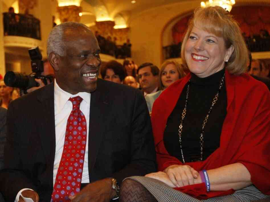 Supreme Court Justice Clarence Thomas sits with his wife Virginia Thomas, as he is introduced at the Federalist Society in Washington on Nov. 15, 2007.