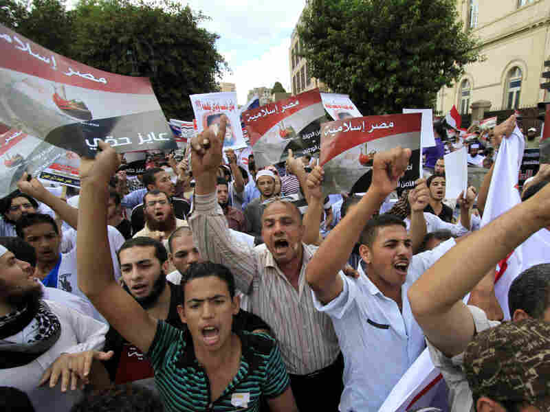 """Demonstrators from a Salafi group chant slogans and hold posters that read, in Arabic, """"Islamic Egypt,"""" during a Sept. 23 protest against emergency law in Cairo. Salafi political parties will be among those vying in upcoming elections."""