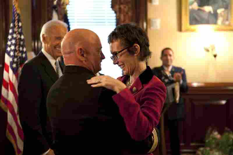 Giffords hugs Kelly on Oct. 6 in the White House after Kelly received the Legion of Merit medal during his retirement ceremony.